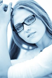 girl with glasses and lovely smile